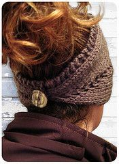cute crocheted ear warmer/headband!like the button idea, wouldn't mess your hair trying to put it on :).