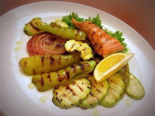 Warm salad with salmon and vegetables cooked on the grill