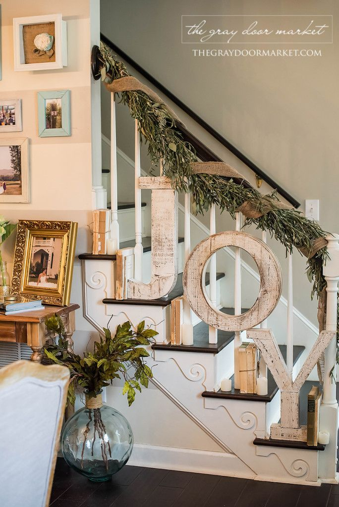 Holiday decorating & ideas - Decorate staircase with large letters and balsam foliage.