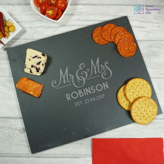 Mr and Mrs Wedding Slate Cheeseboard. Looking for a gorgeous gift for a special couple? This Mr and Mrs Wedding Slate Cheeseboard is a lovely gift for any newlyweds. This modern piece will fit perfectly into any home.  Personalise this wonderful slate cheese board with their surname and established date. Making it a one of a kind gift. Perfect as a wedding or anniversary gift!