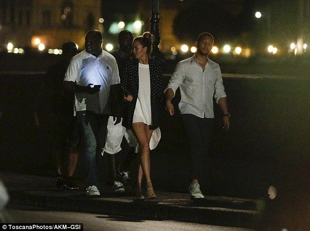 Crew: The couple were joined by some of John's tour managers during their late-night strol...