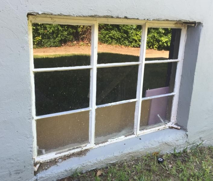 Installing basement windows in concrete plastic tube cutters