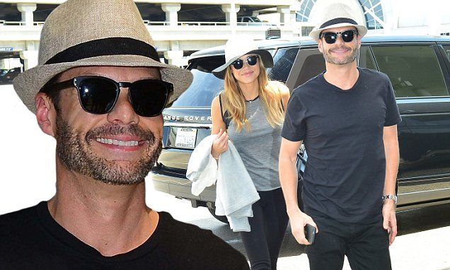 Ryan Seacrest and Hilary Cruz leave for vacation from the LAX airport
