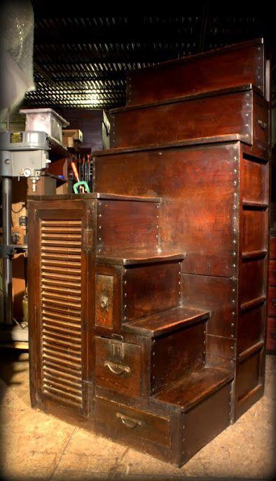 Unusual Kaidan Dansu with access on three sides. Keyaki drawer faces and door panels, Hinoki wood frame, sugi wood drawer interiors. Hand forged iron.  Meiji Era