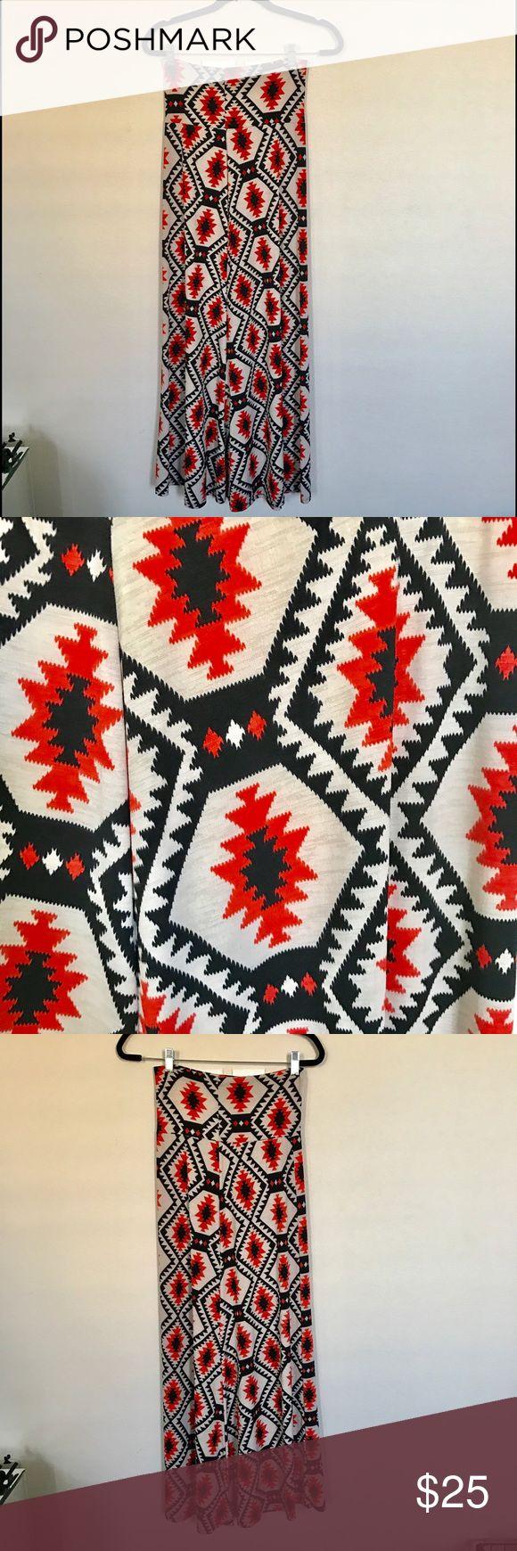 NWOT Aztec Maxi Skirt NWOT Black, orange, and tan Aztec maxi Skirt. Skirts Maxi