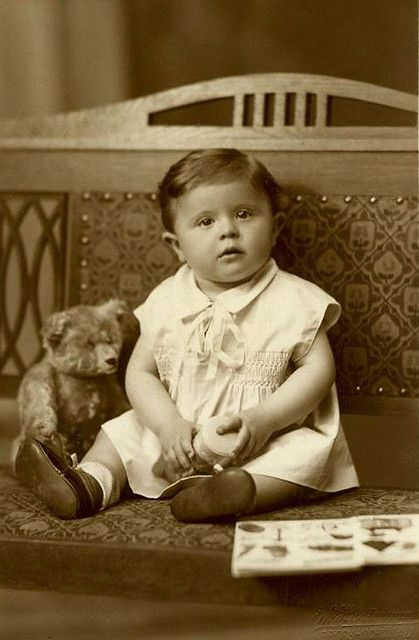 Vintage Photo of a child with her Teddy Bear.