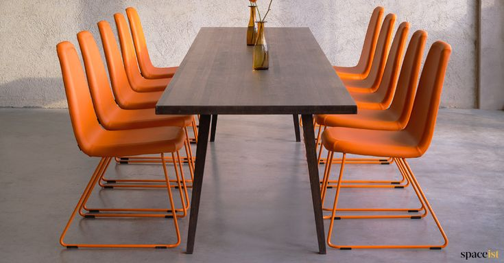 High back meeting chair in orange with an orange base. Seat can be covered in over 60 different colours and the back is available in a low version.