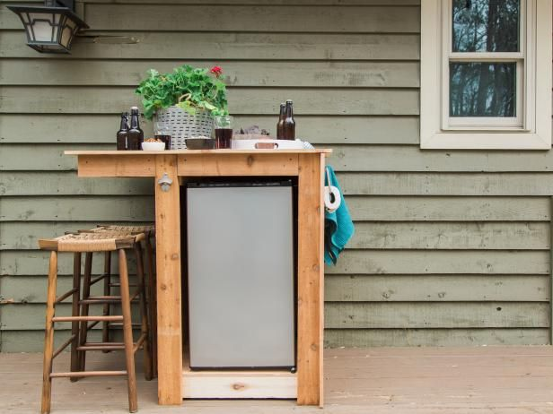 HGTV.com shares step-by-step instructions on how to build a mini outdoor bar complete with a refrigerator and bottle opener.
