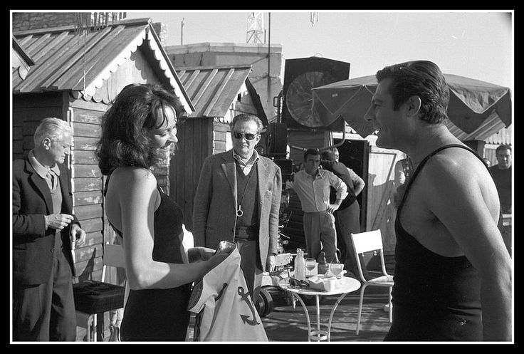 "Anna Karina, director Luchino Visconti and Marcello Mastroianni during filming of ""The Stranger"", photo by Angelo Frontoni, 1967"