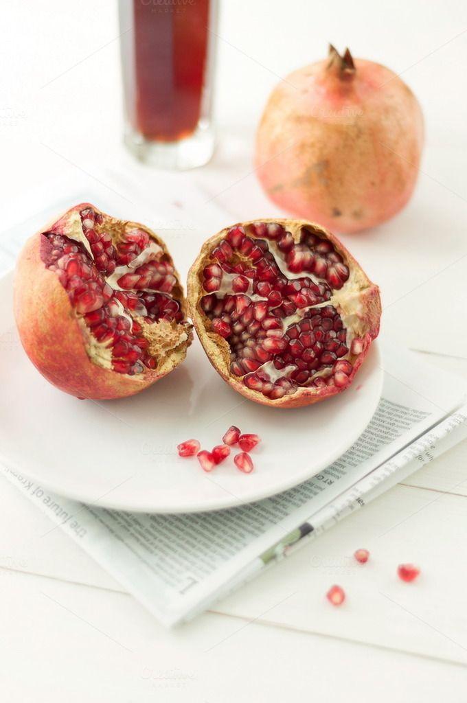 Fresh pomegranates. Portrait by White Nova Studio on @creativemarket