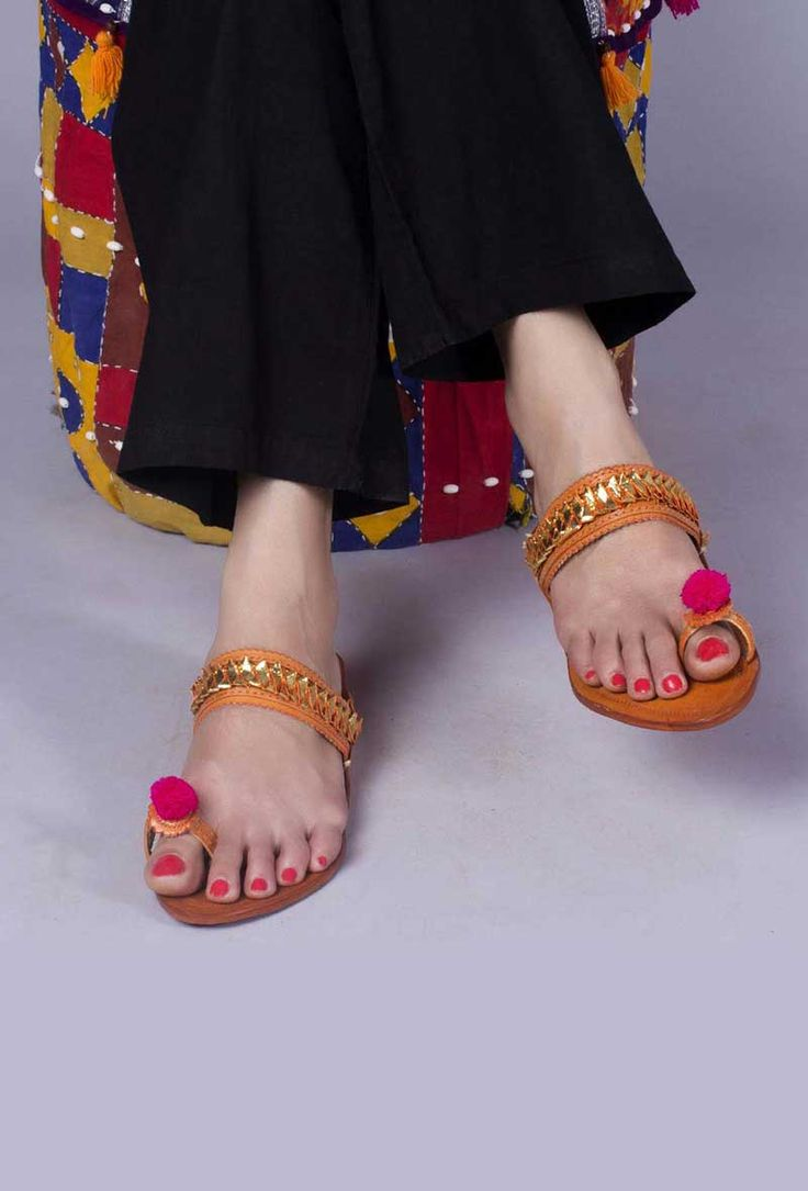 Kolhapuri Chappal Neatly hand crafted Kolhapuri chappals adorned with gota patti and thread embellishments for a classic yet contemporary look Color: Brown & multi-color Material: Genuine leather  Finish: Hand-Made Inspiration: Indian kitsch