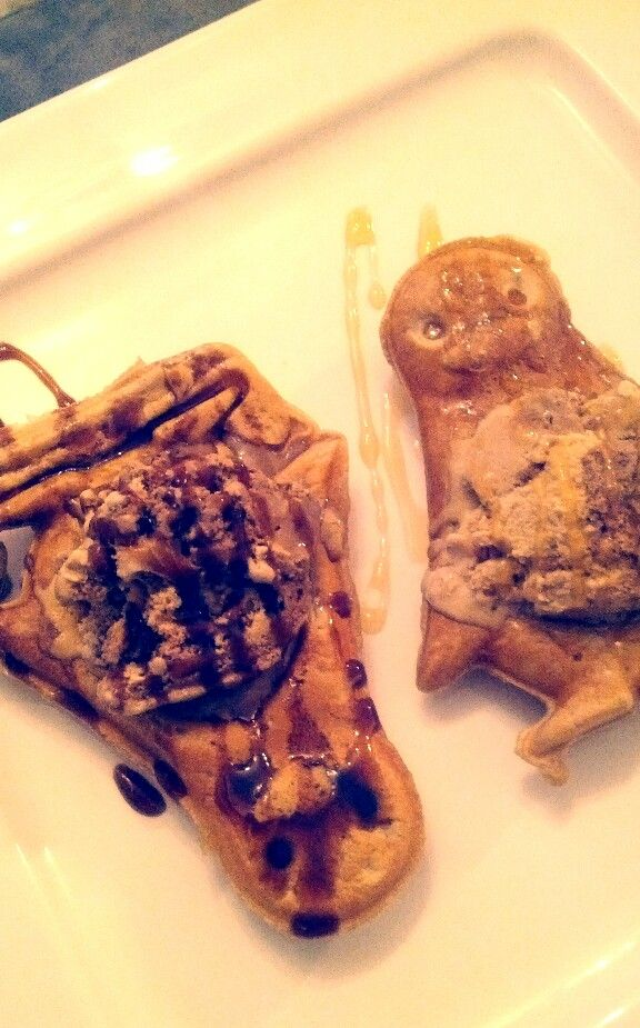 Quick penguin waffles with hazelnut ice cream and syrup and choc sauce