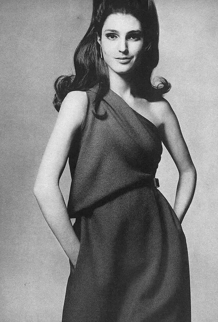 Benedetta in an assymetrical dress in a bright navy blue jacquard-patterned crepe of silk and wool by James Galanos, photo by Gianni Penati for Vogue 1967