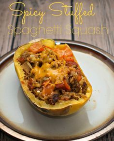 Spicy Stuffed Spaghetti Squash - spaghetti squash stuffed with sausage, tomatoes and zucchini