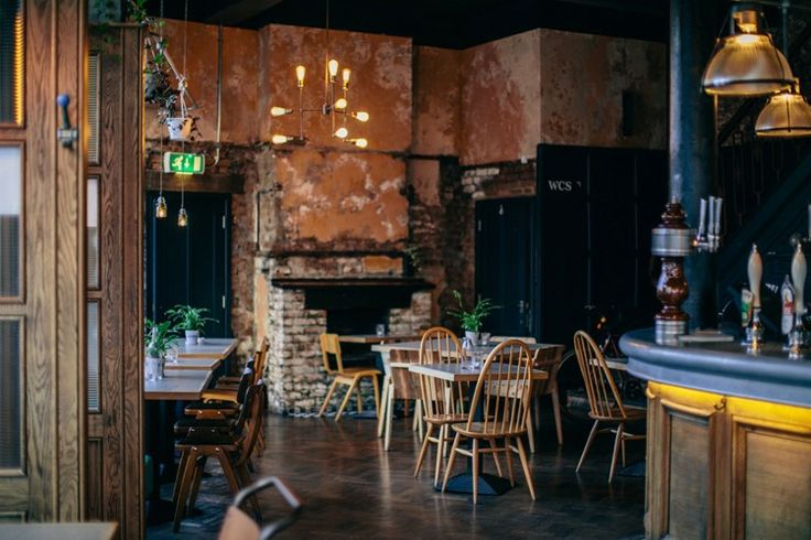 The shabby chic decor has exposed brick walls, original Victorian features and vintage furniture