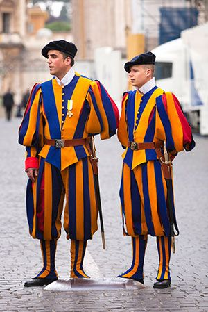 Swiss Guard. The Swiss Guard, recognizable by its armor and colorful Renaissance-era uniforms, has been protecting the pontiff since 1506. That's when Pope Julius II, following in the footsteps of many European courts of the time, hired one of the Swiss mercenary forces for his personal protection. The Swiss Guard's role in Vatican City is strictly to protect the safety of the pope. Its soldiers are extensively trained and highly skilled marksmen and Swiss citizens.