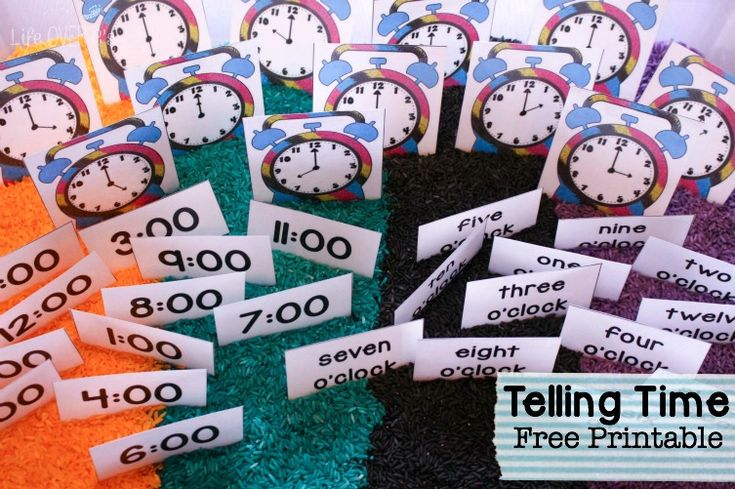 Telling time becomes so much more fun when you combine this free printable for telling time in a tine sensory bin!