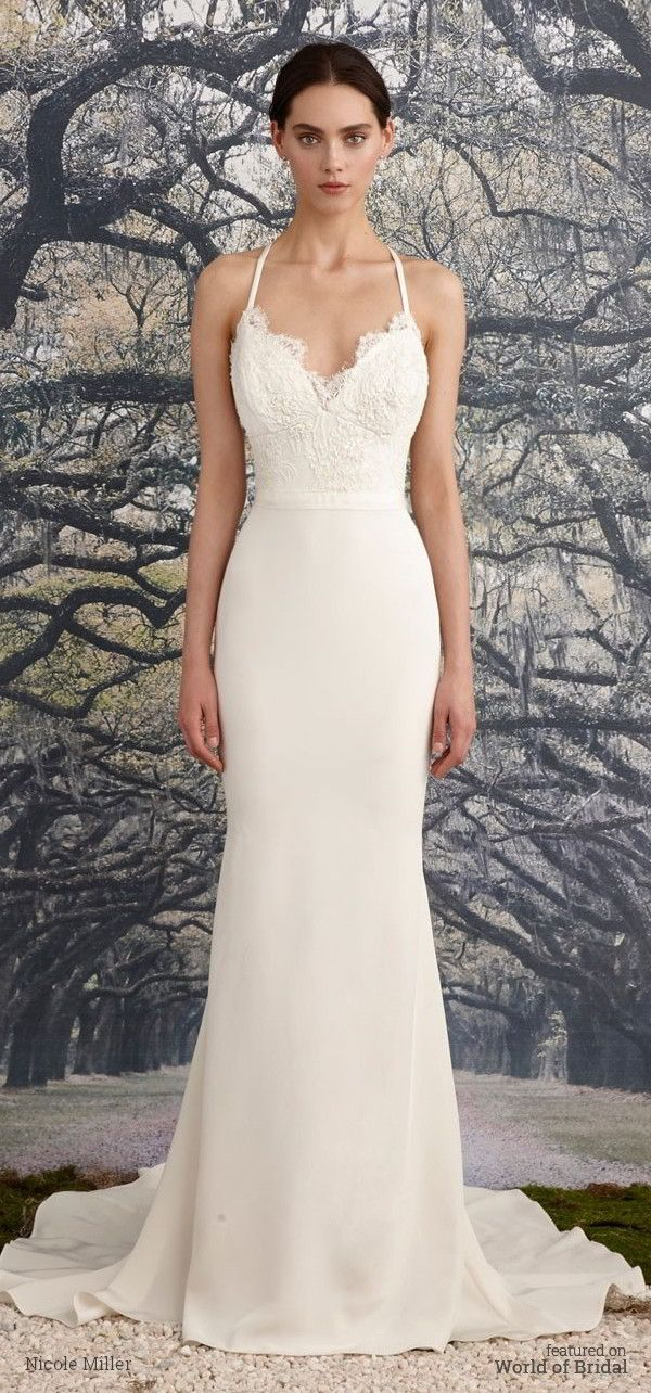 Mermaid gown with a beaded corded scalloped lace bodice and simple waistband. Scalloped deep-v front and back neckline with scalloped lace detail. Criss cross back straps and a fishtail train.