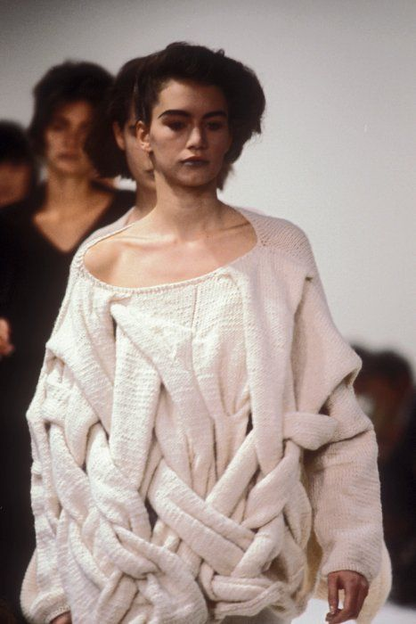 This interwoven knit really challenges the concept of the cable. This almost woven knitwear is a visual tromp d'oil. It has a sense of play however it is also reserved in colour. Credit: Comme des garçons, F/W1983-1984 photo by Guy Marineau