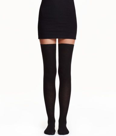 Black. Rib-knit, thigh-high over-knee socks in a soft modal blend.