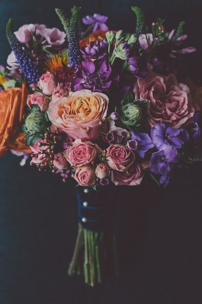 Purple, Pink, orange & peach bright bridal bouquet - Images by Ten 21 Photography - Charlie Brear Satin Gown for an Industrial, Urban City Wedding in Belfast with Bright Florals & DIY decor. Groom wears Designer Hugo Boss Suit & Bridesmaid Wear HighStreet ASOS Dresses.