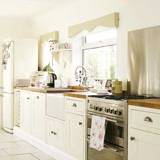 Steel cooker and white kitchen