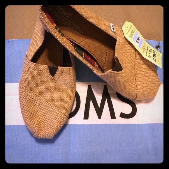 Natural Burlap TOMS  New paid of Toms, never worn! Tags still attached. Women's classic style, natural burlap material! TOMS Shoes