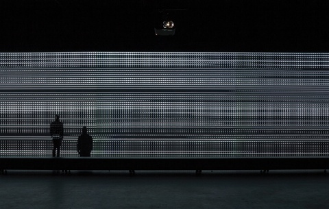 Unidispay = CARSTEN NICOLAI  Sound and image- consists of a single wall/display that is 50 metres long, flanked by two reflecting walls at the corners, thus expanding the images ad infinitum.