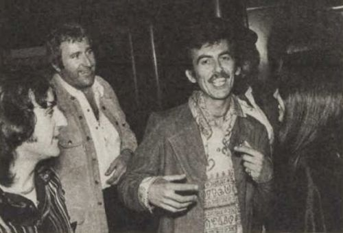 """George Harrison and Olivia Trinidad Arias with Denny Laine and Mal Evans at the Venus and Mars party held by Paul and Linda McCartney and Wings aboard the Queen Mary II, docked in Long Beach, California, 24 March 1975 Photo: The Australian Women's WeeklyIn memory of Mal Evans, 27 May 1935 - 5 January 1976.""""Mal [Evans] was the nicest, gentlest person; he was a big guy, but he was really sweet."""" - George Harrison, The Beatles Anthology"""