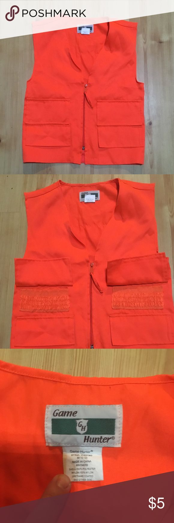 Kids Orange Hunting Vest Game Hunter brand orange hunting vest. Great condition. Has elasticized holders for ammo and pockets for carrying snacks, etc., in both sides of front. Zipper closure. Make sure your child is highly visible when hunting with this bright orange vest! Size M (8-10). Unisex. Non smoking home. Bundle two or more items and save on shipping and receive a discount! Game Hunter Jackets & Coats Vests