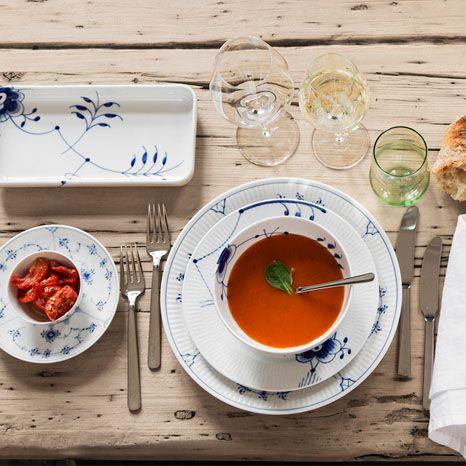 Kay Bojesen Grand Prix dinner fork, dinner knife, lunch fork and lunch knife, all in polished steel. Royal Copenhagen blue elements. Kay Bojesen Grand Prix cutlery/flatware. Danish Design.