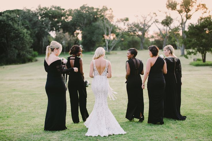 Roxy Burger's fairytale wedding at Forest Hall in Plettenberg Bay. Click for more. Black bridesmaids dresses.