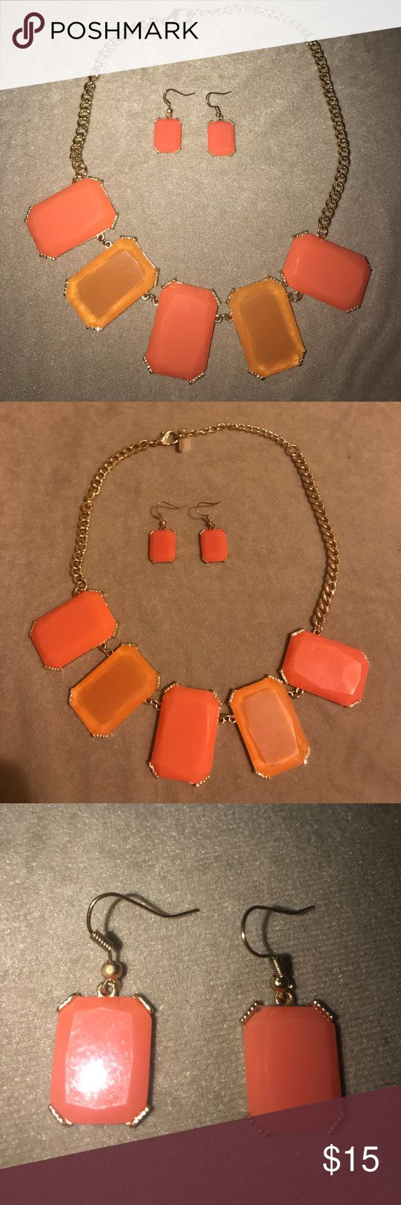 Orange and Coral Statement Necklace and Earrings Beautiful orange and coral statement necklace with gold chain and coral matching earrings. Worn once, great condition. Jewelry Necklaces