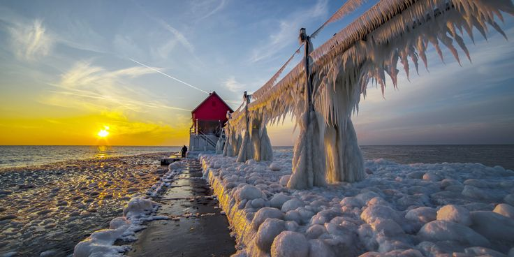 Lighthouses on the shores of Michigan were turned into 30-feet tall icicles after temperatures plunged to -5 degrees earlier this week. These remarkable images taken by photographer Mike Kline show ic