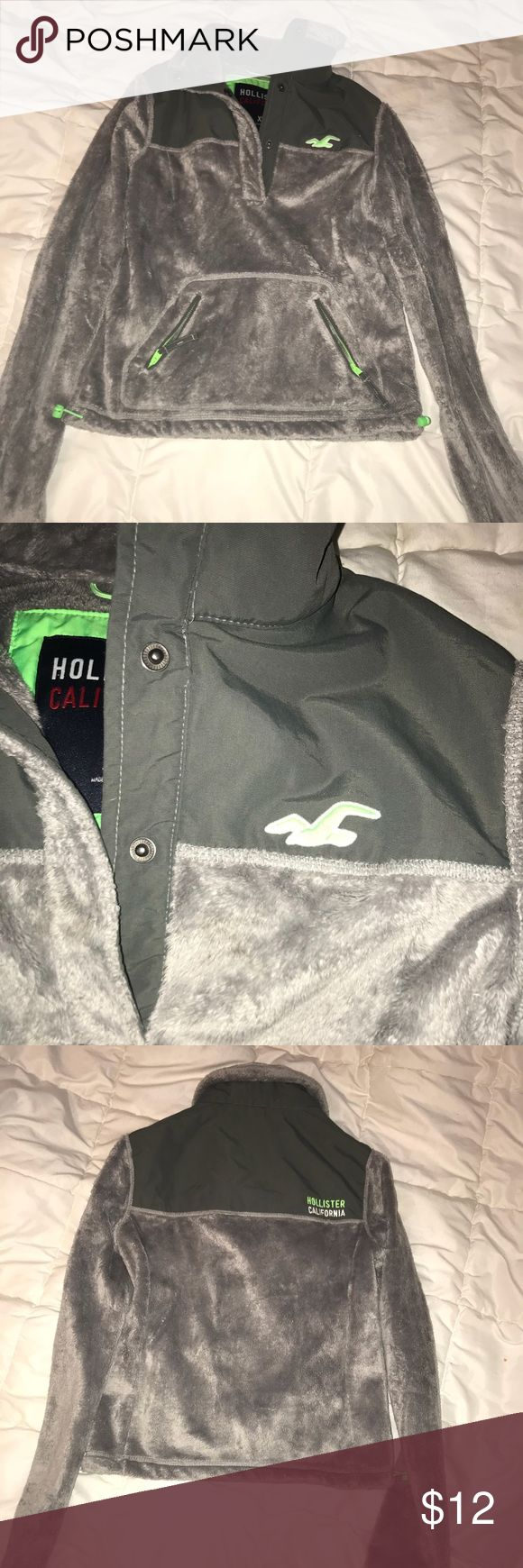 Grey Pullover Grey pullover with Lime green accents. (on inside, on zipper, on tightening strings) Worn few times. Faux fur is soft. Pullover thick and warm. Half button down. Hollister Tops Sweatshirts & Hoodies
