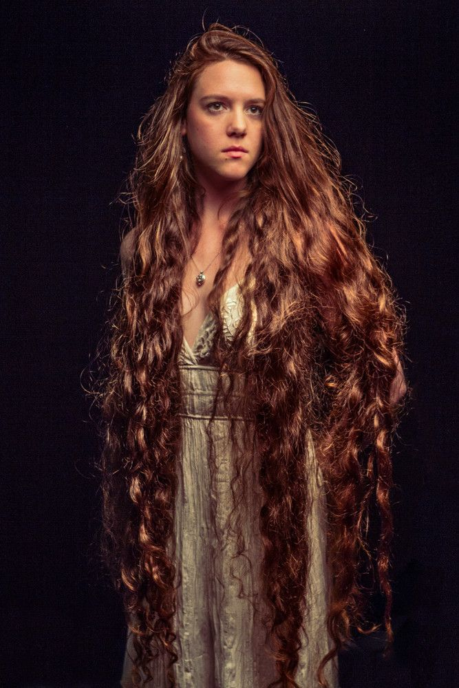 Very long hair.  I would love hair like this.  I wonder how long it took to grow that long!!! Hella long