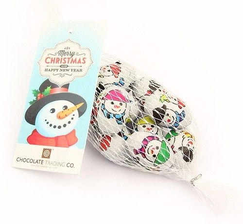 Net of chocolate snowmen eggs by Chocolate Trading Co.  A net of foil wrapped, milk chocolate eggs with a snowman design for Christmas stocking fillers, table settings and token corporate gifts. Complete with a Merry Christmas & Happy New Year gift tag. • Personalise these nets of foiled chocolates with a full colour printed label with your logo and message.  • Minimum order quantity for personalised labels x100 nets. Please call or email for further information.