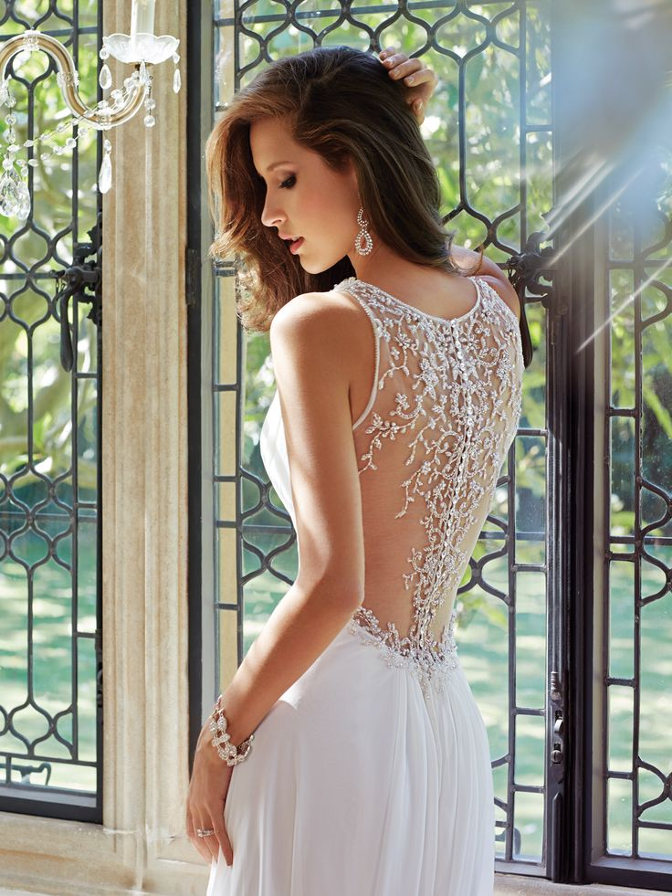 Style Y21435, Joanne, is a beautiful sleeveless chiffon wedding dress with chapel train designed by Sophia Tolli, click here for more details.