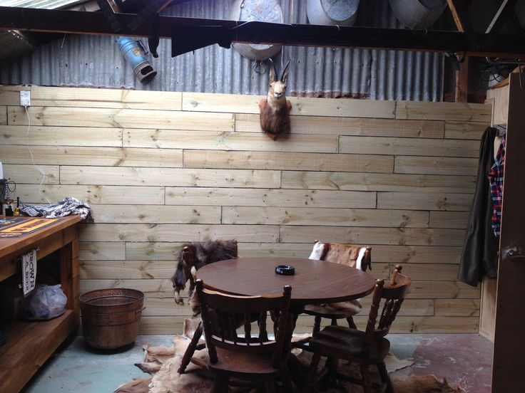 The back wall of hubby's hunting lodge - we created it from old fence palings