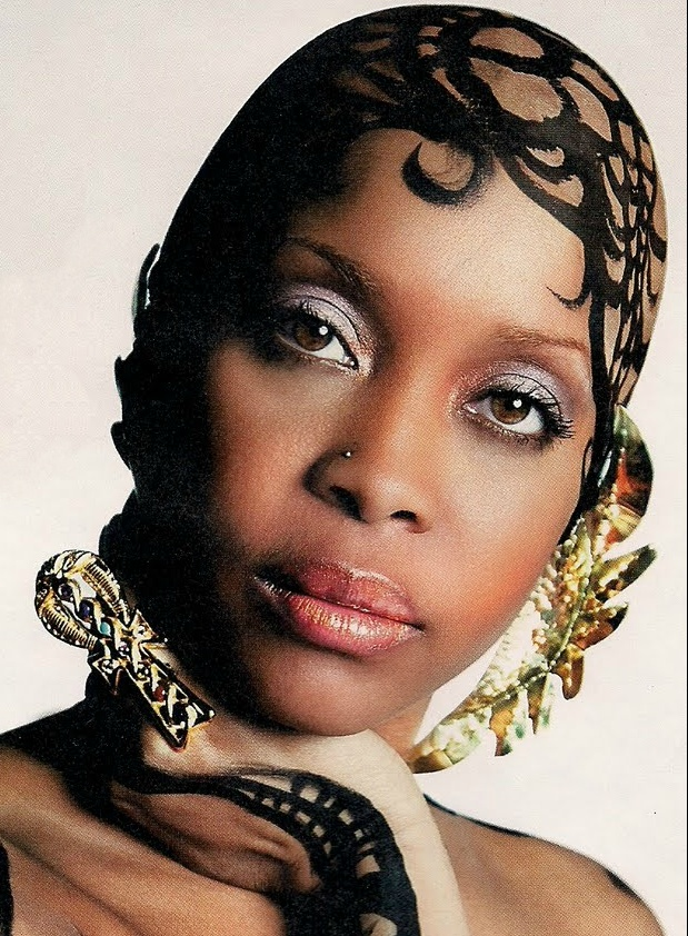 Erykah Badu on VIBE magazine cover. Here Erykah wears 2 of her favorite jeweler's: http://www.soptah.com/ & http://www.etsy.com/shop/baduearwings