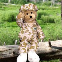 """American G.I. Hero  Send your hero our American G.I. Hero and show him how much you care. This adorable 22"""" bear is all dressed out in his camo outfit and even has a backward American flag sewn on his sleeve like an actual uniform! His mouth moves and he sways to and forth as he sings """"God Bless the USA"""""""