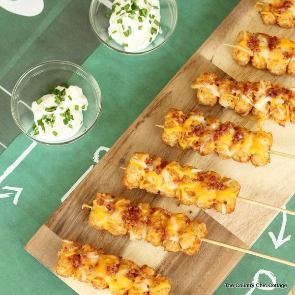 Serve up tater tots on a stick with this recipe for Loaded Tot Kabobs. These are the perfect appetizer for any party but especially for football season.