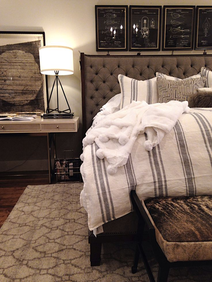 alice lane home collection, upholstered headboard, hair on hide bench, fur throw, striped duvet, striped bedding, black and white art, black lamp