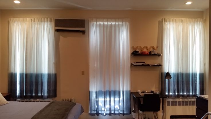 Custom ombre white to blue sheer curtain installation by NY City Blinds.