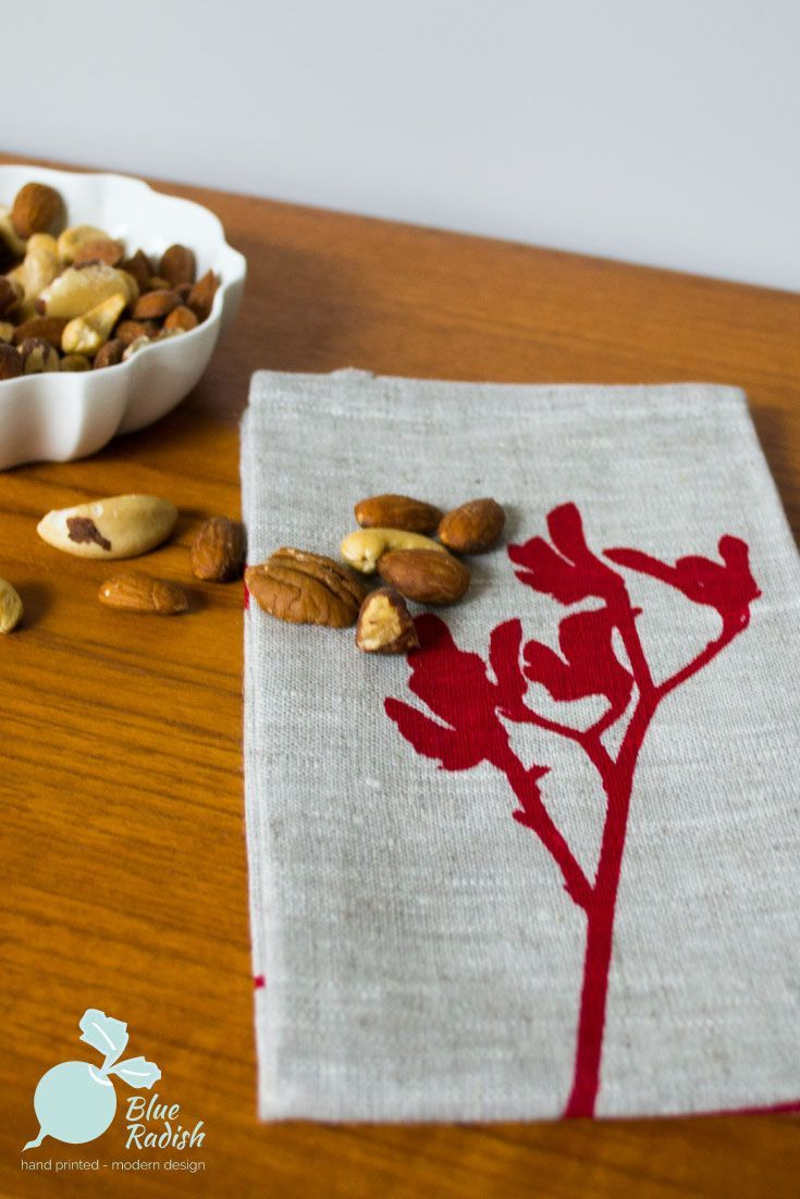 100% linen table napkins. 45cm square. Hand printed kangaroo paw design in red ink onto natural coloured linen. Available as a set of 4.