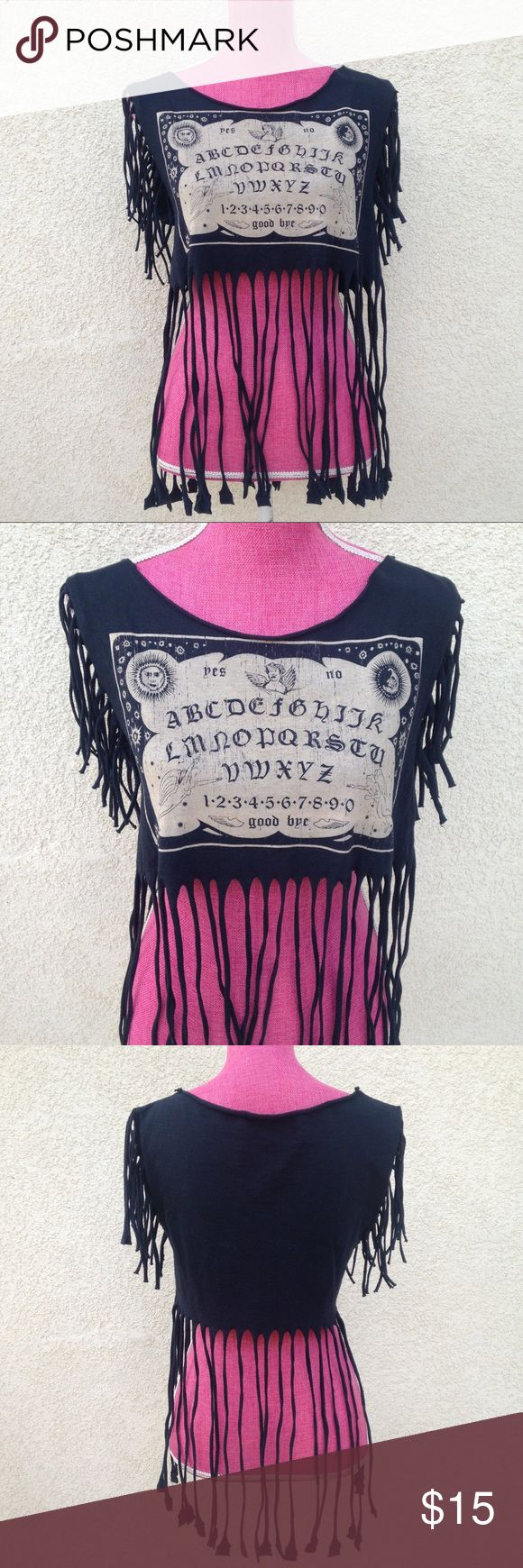Ouija Cropped Fringe Top Ouija Cropped Fringe Top  •Women's size med/large•  •Great Top for a festival or concert!•  •Looks best with high waisted shorts•   •Hand-cut Fringe and Crop•   ✨Every offer is considered!✨ Tops Crop Tops