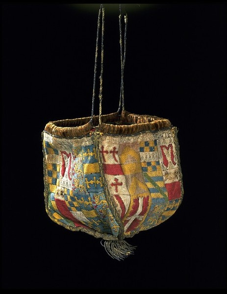 Purse, linen embroidered with silk ca. 1540. his formal, heraldic purse associated with marriage has more significance than a purse used simply for money, or a 'swete-bag' used for carrying perfumed herbs to sweeten the atmosphere. Both men and women carried or wore pouches or purses. The long strings of this example suggest that it was intended to hang from the waist, but it is uncertain whether it was ever actually used as a container.