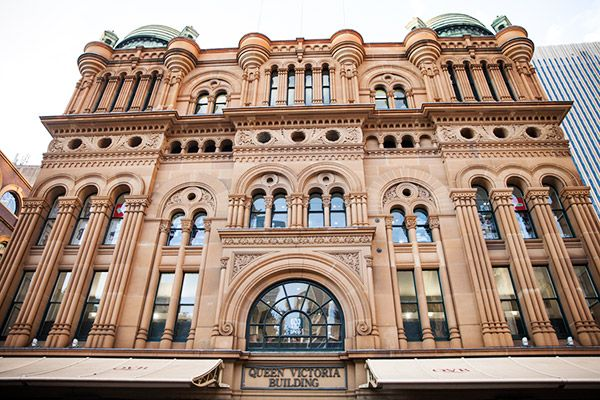 The famous sandstone facade of the Queen Victoria Building in Sydney, in its elegant High Victorian glory.