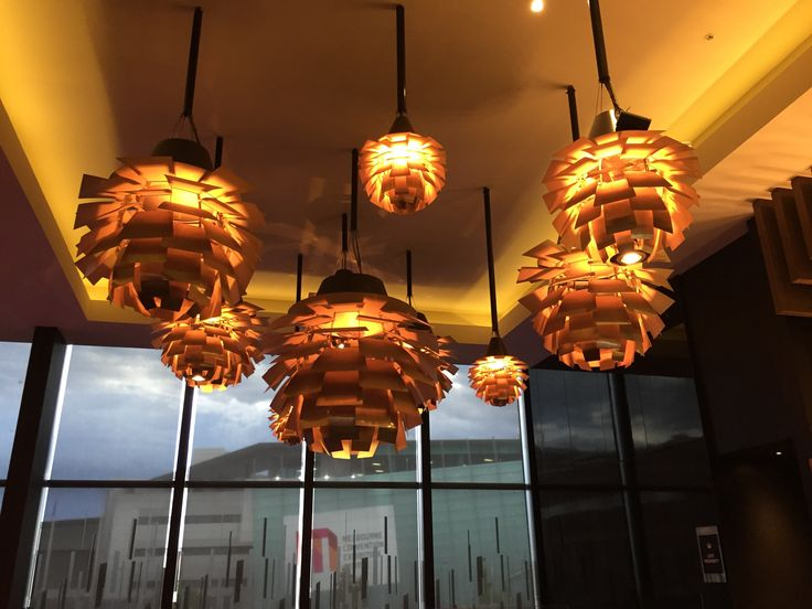 PHOTO TWO: Artichoke Lights-The light globe of this light reflects off the allimunion panels, to create ......  the color of the light changes throughout the day to create a different mood and produce a feeling of a  luxurious environment.