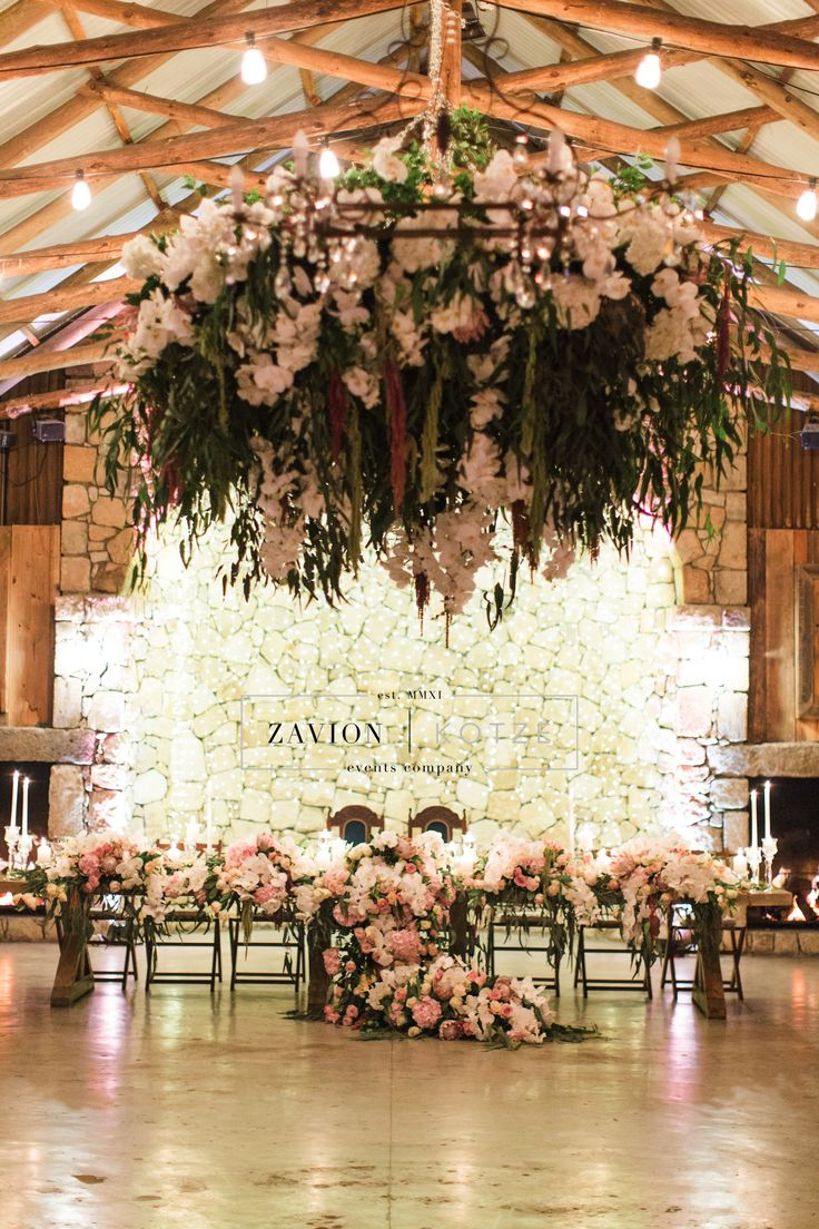Luxury Rustic Wedding, Orchids, roses and Proteas, luxury wedding planner South Africa, Zavion Kotze Hanging flowers